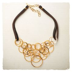 Leather & Gold Ring Necklace.  Cute with t-shirts or dressed up.  This oozes confidence and style!
