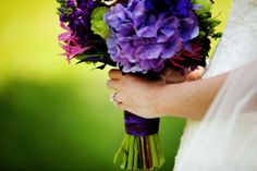 Purple and green themed bridal bouquet created by Lexington Floral in Shoreview, Minnesota.    #weddingflowers #wedding #bride
