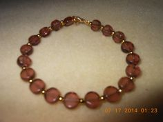 Bracelet, Purple light round with small gold beads and clasp