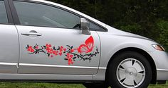 Think I want this (in turguoise/black) for my white PT. ;) Bicolor Flowers and Butterfly car decals (set of 2)