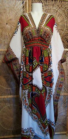 Vintage 1970s Dashiki Maxi Dress-Ethnic India-Caftan-Empire Waist. $60.00, via Etsy.