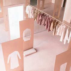 Brooklyn studio Snarkitecture has used pink-hued steel and floor-to-ceiling mirrors to transform an industrial space in Los Angeles into a COS pop-up store