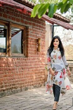 25 Smart Ways To Wear a Dress Over Trousers - Wass Sell White floral dresses with long pant Dress Over Jeans, Dresses With Leggings, Indian Designer Outfits, Designer Dresses, Look Fashion, Indian Fashion, Classy Fashion, White Floral Dress, Floral Dresses