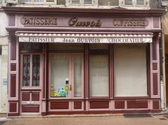 Vintage French Storefront in Nontron Store Fronts, French Vintage, Garage Doors, Outdoor Decor, Home Decor, Decoration Home, Room Decor, Interior Design, Home Interiors
