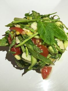 Raw asparagus, avocado and mint salad.  Asparagus is a very seasonal vegetable and we are always looking for new ways to use it when the season comes around. Having never used it uncooked before we thought we would try it shaved thinly w...