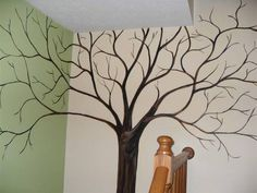 If your resale or consignment shop has an awkward entry, maybe this idea of a painted  tree/ changeable leaves could work for you, suggests TGtbT.com. Heck, I can even see mini price tags with SALE written on them :)