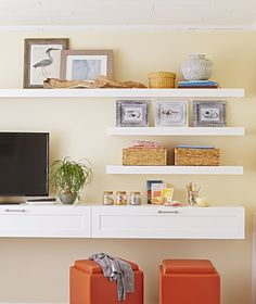 Create an attractive media wall around your TV by combining simple open shelves with storage compartments for electronic gear.