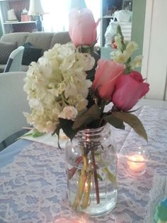 Sweet, romantic, lace bridal shower.  Flower centerpiece for the flower girl table.