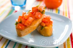 Fresh summer tomatoes & basil make this easy-to-assemble appetizer a five-star dish. Grilled Brushetta. #cleaneating