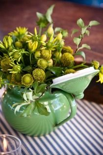 green accents in centerpieces