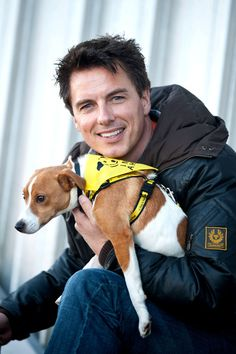 "John Barrowman Photos - Entertainer John Barrowman is seen out promoting the Dog Trust, spreading the message ""A dog is for life, not just for Christmas"". Barrowman happily posed with pups Mouse the Black Labrador and Vincent the Jack Russell Terrier. - John Barrowman Promotes Dog Trust"