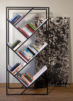 Minimalist Steel Bookcases with Corian or Bamboo Shelves by Faktura