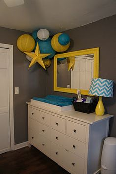 gray, yellow, and blue...  this gives me hope that I can do a mini-transformation in my bedroom. our walls are currently almost this same turquoise...but maybe we can paint one or 2 walls gray and do yellow accents? i LOVE yellow and gray together!