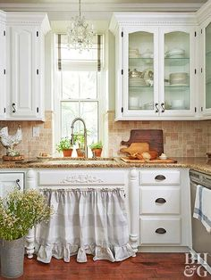 country kitchen with white cabinets and granite counters