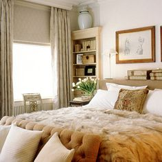 Neutral bedroom by Nicky Haslam with fur bedspread