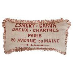 Linen and cotton-blend pillow with fringe detail.          Product: Lumbar pillow    Construction Material: Linen and cotton    Color: Red and linen    Features:   Bold yet sophisticated pattern  Made in the USAInsert included      Dimensions: 12 x 24    Cleaning and Care: Dry clean only