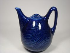 """Blå Eld by Hertha Bengtson for Rörstrand  The Blå eld - Blue fire - range was designed by Hertha Bengtson and produced by Rörstrand between 1949 and 1971. It has become a classic design icon, not only in Scandinavia but all over the world.  Tea pot. Height: 18,5 cm (7.3"""") Weight: 0,65 kg (1.4 lbs)"""