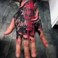 Red Brush Stroke Ink Over Skull Hand Tattoos For Males