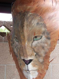 I painted this lion head on a palm frond and sealed with a clear coat.