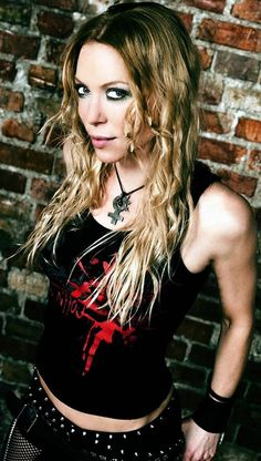 Angela Gossow, previously of Arch Enemy. Reason #7: The chicks, and the fact that they rock.