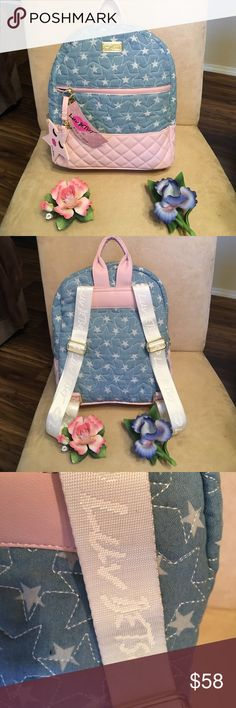 ❤️️Must have Back Pack ❤️️ STATEMENT BACK PACK  This back pack is by Betsey Johnson.  So you know the quality is above par.  This features a light denim like material on the outside and Betsey's signature striping on the inside. Features a larger pocket on the outside and ample room on the inside.  Also comes with a super cute keychain (see pic). NWT Betsey Johnson Bags Backpacks