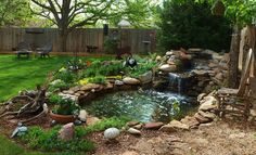 A half circle of retaining wall brick in back built up with clay and dirt in front pvc pipe runs from skimmer box to top of pond creates the waterfall... pond liner and donated rock... 4 ft deep and basically everything except the liner we got off of craigslist. even the koi.