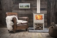 Charnwood Bembridge Wood Burning Stove - Charnwood, have teamed up with Country Living Magazine and produced a stunning new wood burner. Wood Burning Logs, Freestanding Fireplace, Freestanding Stoves, New Stove, Country Living Magazine, Log Burner, Reading Room, Hearth, Door Handles