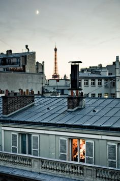 Paris, France- looking into an apartment, over the rooftops, and at the eiffel tower in the distance.inspiration for your Paris vacation from Paris Deluxe Rentals Tour Eiffel, Midnight In Paris, Paris Rooftops, Grand Paris, Parisian Apartment, Apartment Layout, Dream Apartment, Apartment Interior, Apartment Living