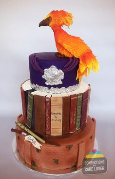 Harry Potter Wedding Cake! All-in-all the cake took about 30 hours of work. White and chocolate cake with vanilla buttercream and banana with cream cheese, SMBC and fondant. All edible including Fawkes, books, silvered Hogwarts crest medallion,...