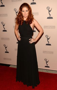 Debra Messing in Black Halter Gown from New York Vintage for An Evening Honoring James Burrows' at Academy of Television Arts & Sciences on October 7, 2013