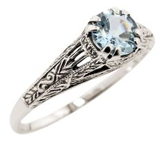 Vintage Style Sterling Silver Filigree 1.00ct Sky Blue Topaz Ring (sz 6). 6.0mm genuine sky blue topaz. 1.00 carat. Filigree with embossed details. Antique reproduction.