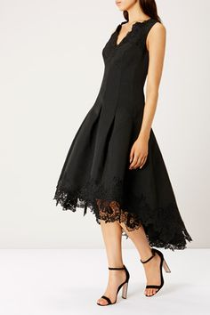 The elegant Limited Edition Messina Lace Trimmed Dress is perfect for your special occasions with its beautiful fit and modern high low laced hem. The panelled waist and box pleats cinch in the waist whilst the full skirt creates a stunning silhouette. This sophisticated dress is the perfect option for a statement look this season. Dress measures 124cm/48.8 inches from side neck point to back hem. Height of model shown: 5ft 9inches/175cm. Model wears: UK size 10.