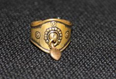 Items similar to Vintage bronze Kalevala Koru Heart ring made in Finland, adjustable size on Etsy