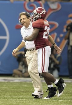 A happy Nick Saban with Javier Arenas