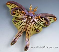 Moth focal bead, polymer clay by Christi Friesen.   #polymer #insect  #moth…