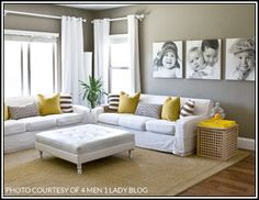 Lovely Family Room - white furniture, family pictures, splash of yellow color with pillows.