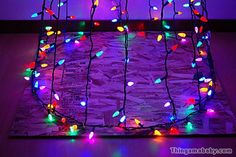 Photo of the particle board square with Christmas lights attached.