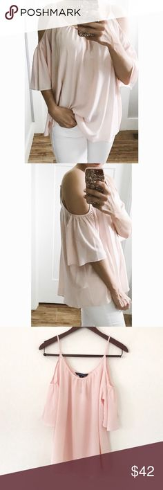"""blush pink cold shoulder top French Connection  Paint the town pastel with this ultra-lightweight Crepe top. It features a wide scoop neck, gathers at the neckline that naturally create pleats at the body and cold-shoulder detailing to showcase beautifully sun-kissed shoulders. Define its oversized silhouette by tucking the hem into high-waisted denim shorts. Color is """"Pink Opal.""""  size: medium  approx measurements:         •bust across:        •length: condition: new with tags  all of my…"""
