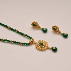 Anvi's uncut stones (small) and emeralds pendent and earrings with emerald beads Kids Gold Jewellery, Gold Jewelry Simple, Gold Jewellery Design, Emerald Jewelry, Bead Jewellery, Beaded Jewelry, Jewelery, Quartz Jewelry, Gold Earrings Designs