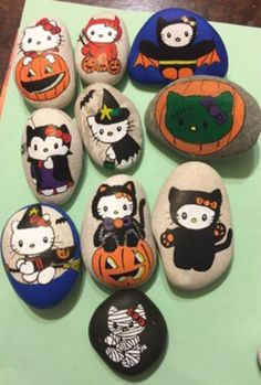 Hello Kitty, in costume, halloween painted rocks, party favors decor stones, rock paintings, itty bitty hello kitty rocks by ArtOfMinebyNikki on Etsy https://www.etsy.com/listing/557495597/hello-kitty-in-costume-halloween-painted