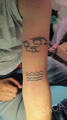 ja-ca:    tattoo, sea and clouds