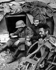 German Army soldiers eating rations among the ruined walls of the industrial district of Stalingrad, today Volgograd. Stalingrad, October 1942.