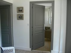 Except i would run the dark trim to the floor. Paint doors and trim rich dark gray. Can't find name of this color but it's close to Chelsea Gray by Benjamin Moore. Grey Interior Doors, Painted Interior Doors, Interior Trim, Painted Doors, Dark Doors, Grey Doors, Dark Trim, Grey Trim, White Trim