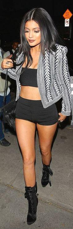 Kylie Jenner: Jacket, shirt, shorts, and shoes – Balmain  Bracelet – Cartier  Purse – 3.1 Phillip Lim