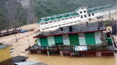 Flooded Dharampur sarkaghat distt Mandi Himachal Pradesh India market and bus station after a cloud burst in Mandi district on Saturday. (Source: Express photo)