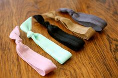 DIY Elastic Hair Ties - I go through a lot of these (mostly because I lose them).  Through craft stores and etsy you can find elastic in any color!