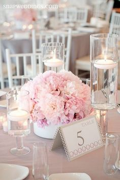 Pretty pink floral centrepieces by Ionian Weddings #tabledecor #mediterraneanweddings