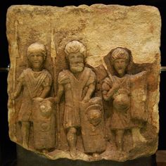 Relief of three legionaries from Croy Hill on the Antonine Wall. Perhaps a fragment of a gravestone, the soldiers are equipped with flat-tanged heavy pila (javelins), cylindrical scuta (shields) and helmets. The carving on the shoulder of the righthand figure may represent lorica segmentata, or it may simply be the folds of clothing. All three figures wear the paenula cloak. In the National Museum of Scotland, Edinburgh.