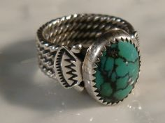 Turquoise ring with twisted square wire shank. Serrated bezel strip and the nice piece of probably Chinese turquoise suggest late 20th century. Unknown maker.