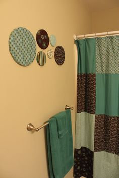 In my bathroom, styrofoam circles covered in fabric to match homemade shower curtain